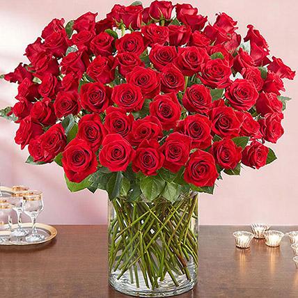Ravishing 100 Red Roses In Glass Vase: Anniversary Gifts