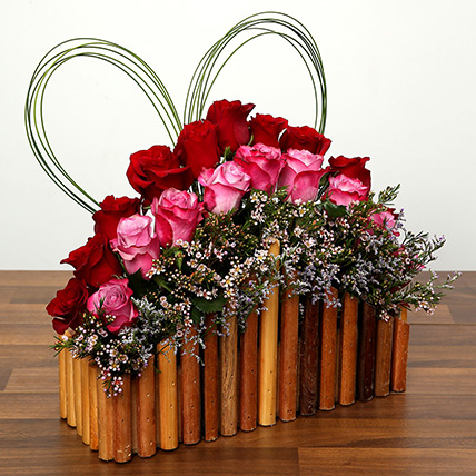 Red and Purple Roses In A Wooden Base: Valentine Gifts to Ajman