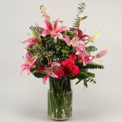 Gorgeous Flowers In Cylinder Vase: Saudi Arabia Gift Delivery