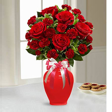 Red Blend Of Roses And Carnation In A Glass Vase